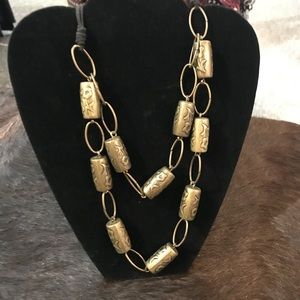 Necklace with elongated metal beads
